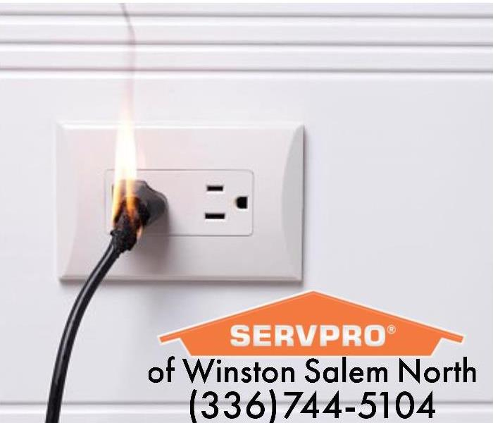 electrical plug on fire