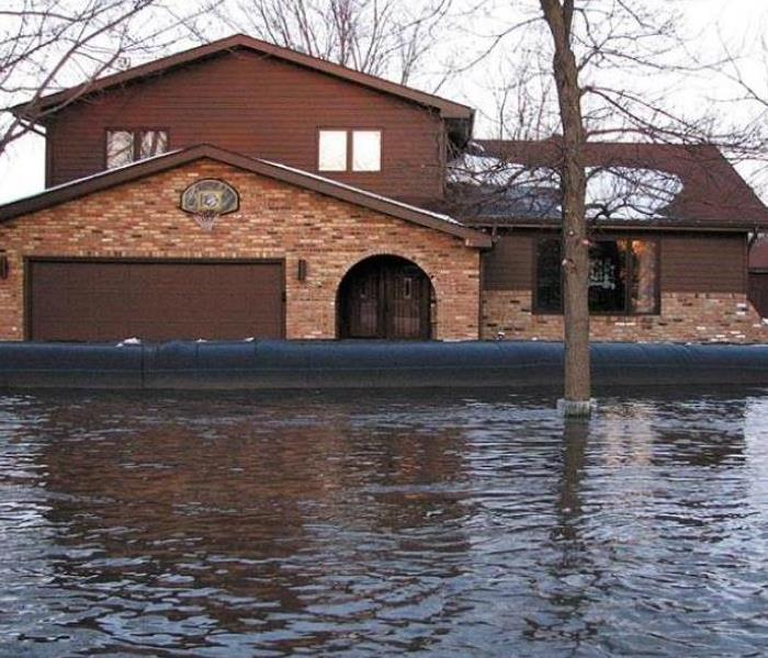 house surrounded by flood waters