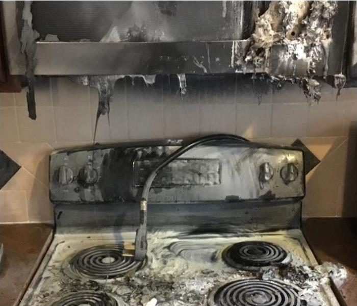 stove and microwave burnt and melted from fire