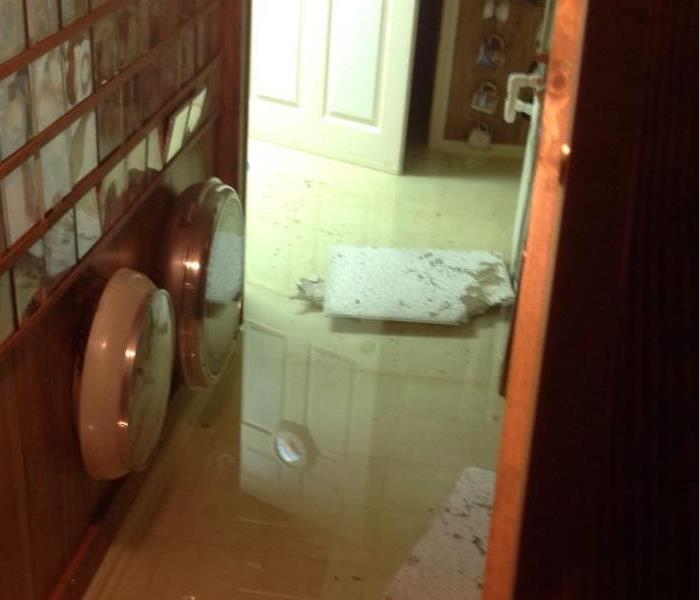 flooded den with books and water everywhere