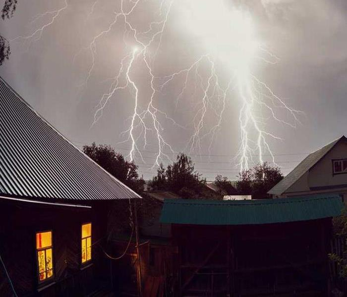 lightning storm around brick house